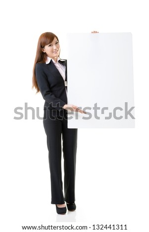 Attractive business woman hold empty blank board, full length portrait isolated on white background.