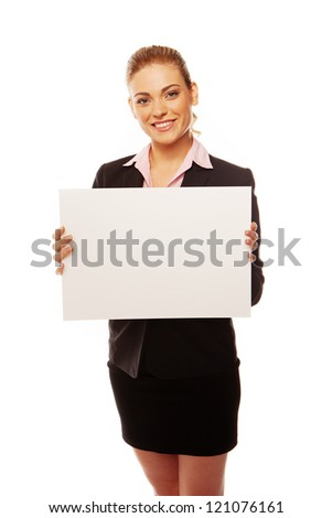 Attractive business woman holding a blank white board isolated on white - stock photo