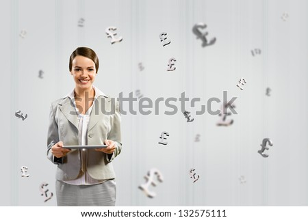 attractive business woman holding a tablet and smile, financial concept - stock photo