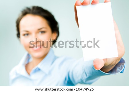 Attractive business woman holding a white business card
