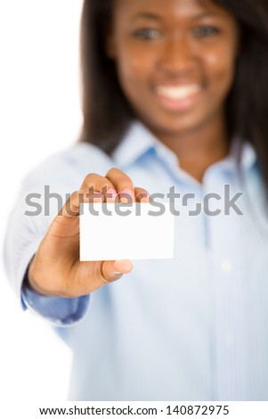 Attractive business woman holding business card in front of her, isolated on white background - stock photo