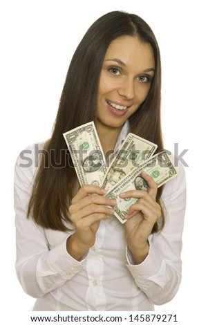 Attractive business woman holding dollars. Isolated - stock photo