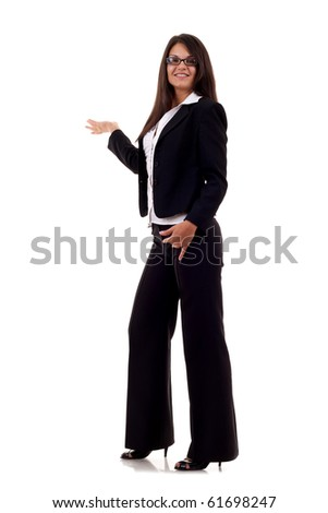 Attractive business woman in suit presenting over white background - stock photo