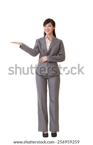Attractive business woman introduce with hand, full length portrait on white background. - stock photo