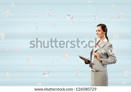 Attractive business woman is working with the tablet, Concept of digital technology - stock photo