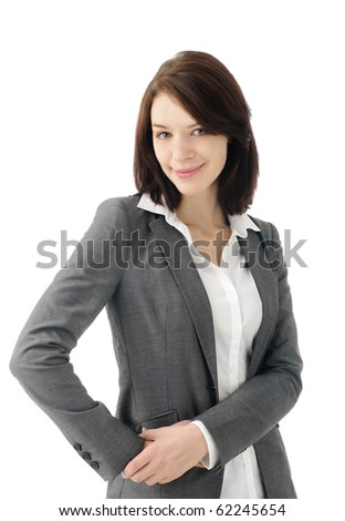 Attractive business woman looking at camera - stock photo