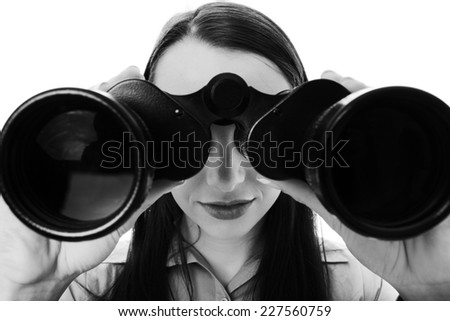 attractive business woman looking through binoculars - stock photo