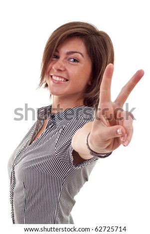 attractive business woman making the victory sign over white - stock photo