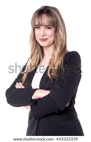 Attractive business woman posing with folded arms. - stock photo