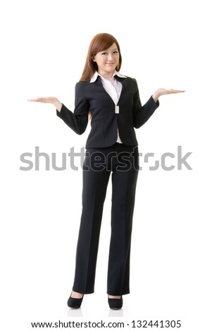 Attractive business woman showing and introducing, full length portrait isolated on white background. - stock photo