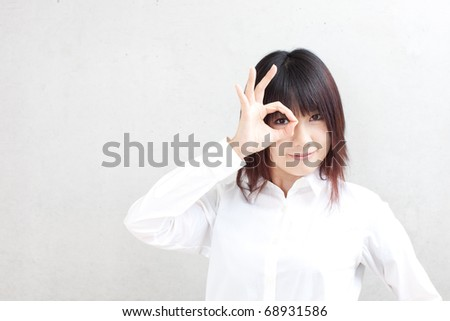 attractive business woman showing OK sign - stock photo