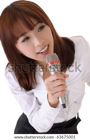 Attractive business woman singing with microphone, closeup portrait.