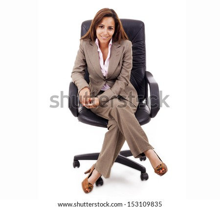 Attractive business woman sitting in chair, isolated over white background - stock photo