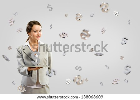 attractive business woman smiling and holding a tablet, around 3d flying dollars, concept of business success - stock photo
