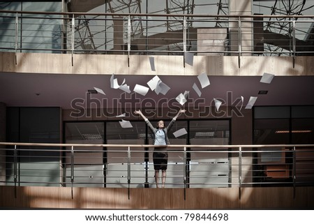 Attractive business woman throwing documents