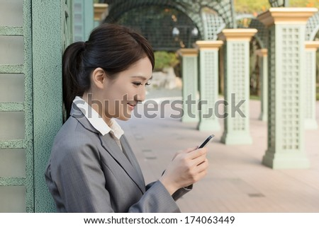 Attractive business woman use smart phone, closeup portrait in city. - stock photo