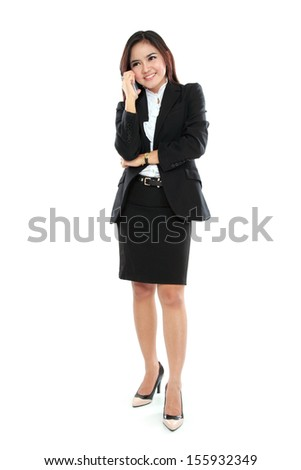 Attractive business woman using a mobile phone against a white background - stock photo