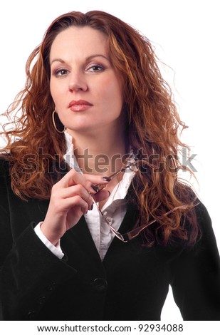 Attractive business woman with glasses in her hand posing isolated on white