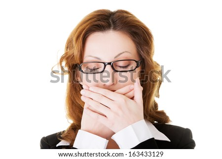 Attractive business woman with hands on her mouth. Isolated on white.  - stock photo