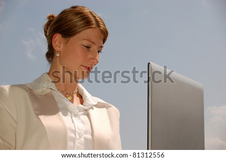 Attractive business woman with laptop - stock photo