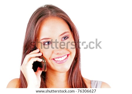 Attractive business young woman talking on a cell phone
