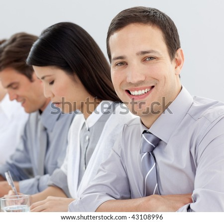 Attractive businessman at a conference with his team in the office