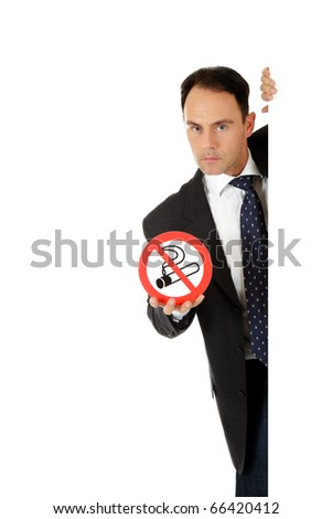 "Attractive businessman behind wall showing ""no smoking"" sign. Copy paste. Studio shot. White background. - stock photo"