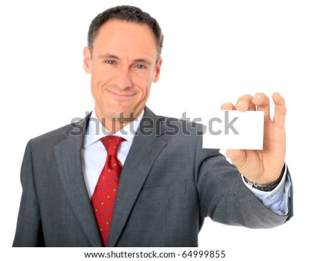 Attractive businessman holding business card. All on white background. - stock photo