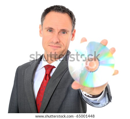 Attractive businessman holding dvd. All on white background. - stock photo