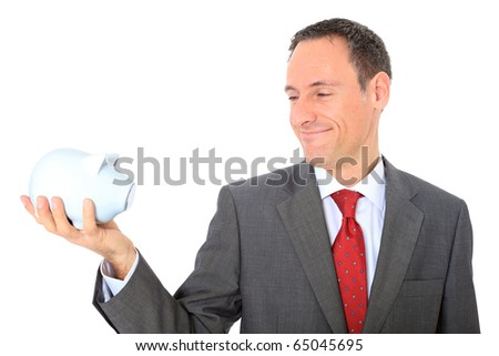 Attractive businessman holding piggy bank. All on white background. - stock photo