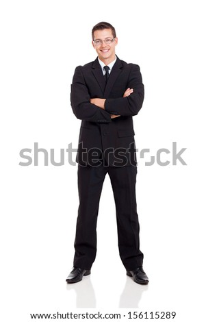 attractive businessman in a suit with arms crossed isolated on white