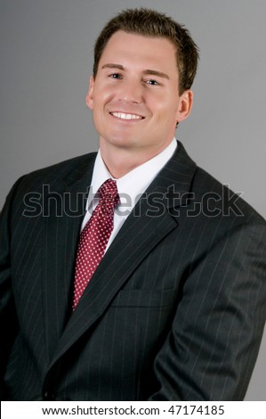 Attractive businessman in suit - stock photo