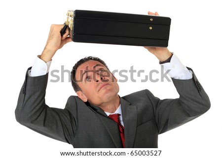 Attractive businessman protecting himself with his briefcase. All on white background. - stock photo
