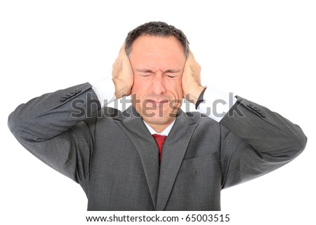 Attractive businessman shuts his ears. All on white background. - stock photo