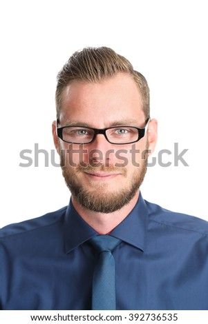 Attractive businessman wearing glasses and a blue shirt with blue tie and pants. Standing in front of a white background. - stock photo