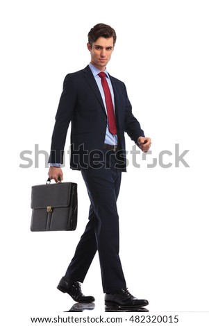 attractive businessman with suitcase stepping forward on white background