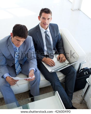 Attractive Businessmen relaxing before a job interview in a waiting room