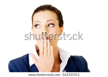 Attractive businesswoman covers her mouth. isolated on white. - stock photo