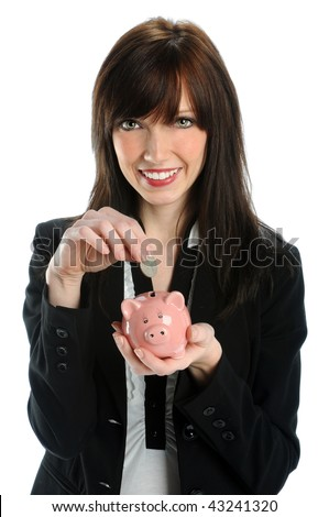 Attractive businesswoman depositing coin in piggy bank isolated over white background - stock photo