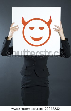 attractive businesswoman devil board