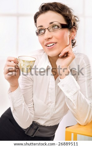 Attractive businesswoman dreaming - stock photo
