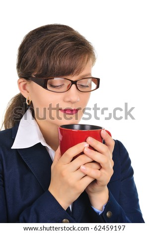 Attractive businesswoman enjoying a cup of coffee - stock photo