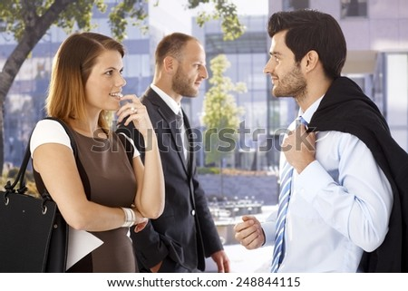Attractive businesswoman flirting with colleague after meeting on the street. - stock photo