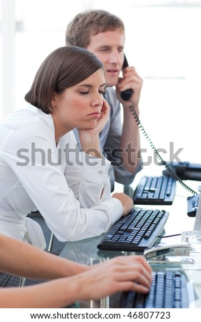 Attractive businesswoman getting bored at work in a company - stock photo