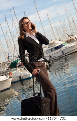 Attractive businesswoman going on a business trip - stock photo