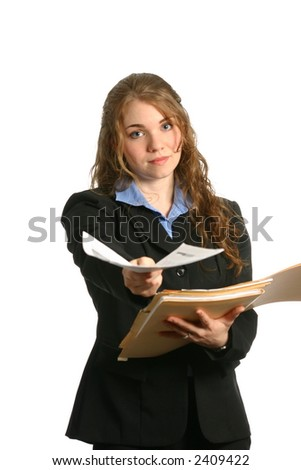 attractive businesswoman handing over a file from folder - stock photo