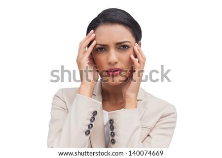 Attractive businesswoman having a headache on white background - stock photo