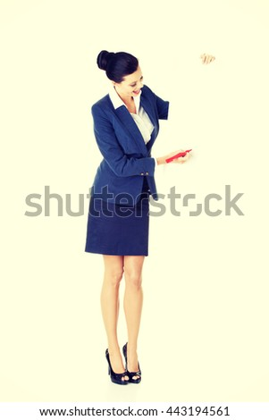 Attractive businesswoman holding blank board - stock photo