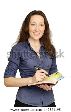 Attractive businesswoman holding documents