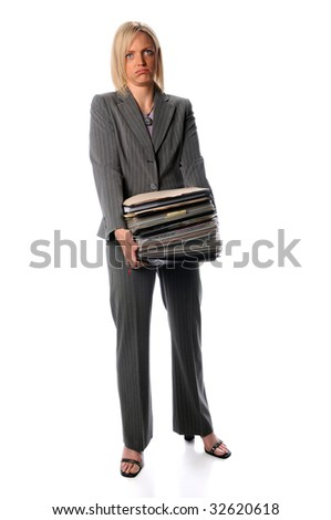 Attractive businesswoman holding stack of paperwork isolated over white